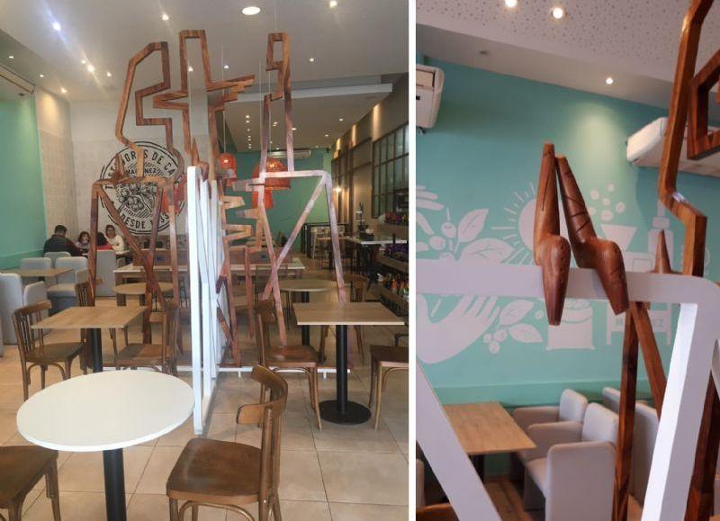 La escultura de Fabriciano Gómez interviniendo la ´M´ de la marca Café Martínez.